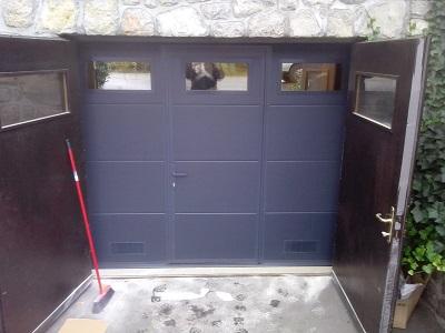 Sekcijska garažna vrata - siva gladka lamela