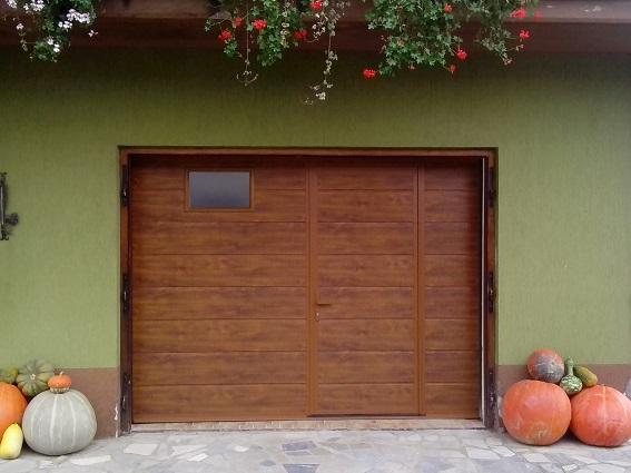 Sekcijska garažna vrata z osebnim prehodom, Daljinček